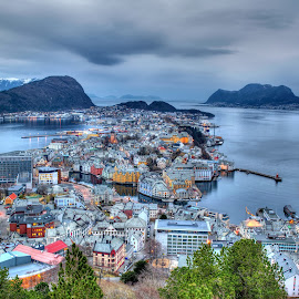 City of Alesund in Norway by Péter Mocsonoky - City,  Street & Park  Vistas ( port, illuminated, reflection, europe, street, ocean, cityscape, architecture, house, travel, coastline, landscape, coast, panorama, city, fjord, norway, island, mountains, sky, alesund, nature, scandinavian, water, houses, scandinavia, twilight, art, beautiful, sea, tourism, scenic, landmark, urban, european, norwegian, blue, bay, background, outdoors, summer, night, view, town, panoramic )