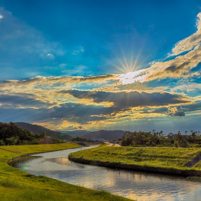 Sunset on the riverside by Jay Chen - Landscapes Sunsets & Sunrises ( riverside, green, sunset, cloud, sun, river )