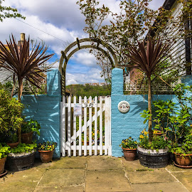 Strawberry Cottage by Michael Lobisch-Delija - City,  Street & Park  Neighborhoods ( england, sussex, pottery, door, painted wall, flowers, garden, hastings, pittoresque, gate, relax, tranquil, relaxing, tranquility )