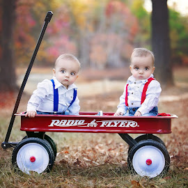 Two is better than One by Jeannie Meyer - Babies & Children Child Portraits ( canon, fall portraits, red wagon, leaves, radio flyer, twins )