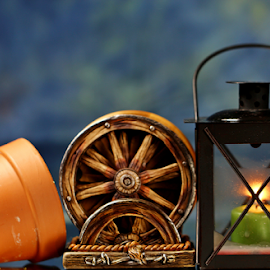 by Dipali S - Artistic Objects Still Life ( candle, lantern, wheel, gardening, pot )
