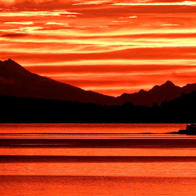 Dawn Delivery by Campbell McCubbin - Landscapes Sunsets & Sunrises ( mountain, red, dawn, silhouette, fishboat, sunrise,  )