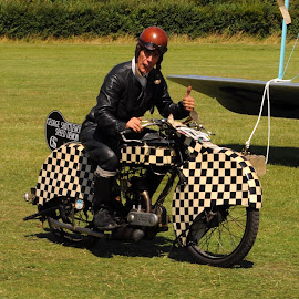 Shuttleworth Snap by DJ Cockburn - People Portraits of Men ( shuttleworth snap, motorbike, chequer, george formby, biggleswade, tribute, museum, shuttleworth collection, england, old warden, bedfordshire, motorcycle, graeme hardy, airfield, triumph model p, antique, britain )