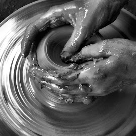 Hands of the Potter by Kevin Frick - People Body Parts ( pottery, hands, spin,  )