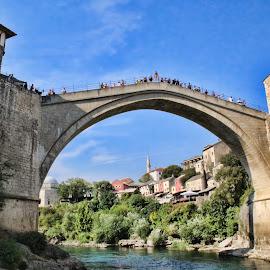 Stari Most Bridge (Mostar, Bosnia Erzegovina) by Gianluca Presto - Buildings & Architecture Bridges & Suspended Structures ( water, peple, old, arch, stone, architectural detail, architecture, historic, city, sky, buildings, bosnia, high, bridge, mostar, medieval, river )