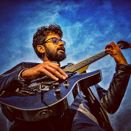 Bleak by Soham Mukherjee - People Musicians & Entertainers ( sky, guitarist, guitar, deep blue, portrait )