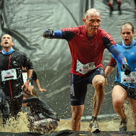 Christian In Front by Marco Bertamé - Sports & Fitness Other Sports ( water, 1186, christian, differdange, splash, splatter, number, soup, running, luxembourg, 1381, massimo, 1583, red, strong, blue, determined, brown, strongmanrun, man, crowded )