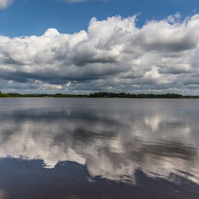 Clouds reflecting by Benny Høynes - Landscapes Cloud Formations ( canon, water, clouds, sweden, sky )