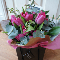 Hot pink tulips, eucalyptus and wax flower hand tied bouquet - The Florist Tunbridge Wells