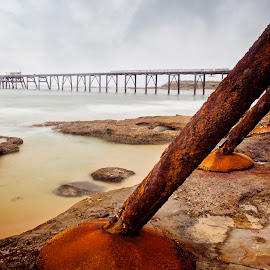 Rusty Beach by Kimberly Starr - Buildings & Architecture Other Exteriors ( water, sand, pier, beach, rust, rocks )