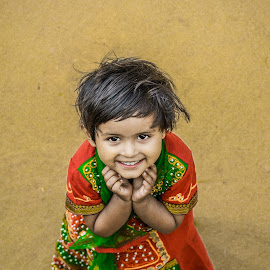 the beauty by Suman Mukherjee - Babies & Children Child Portraits ( girl child, red, india, beauty, smile )