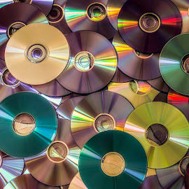 DVD disk by Opreanu Roberto Sorin - Artistic Objects Other Objects ( optical, computer, reflection, ray, technology, disk, writable, data, equipment, circle, object, digital, cdrw, disc, heap, software, compact, recordable, pile, laser, cd-rw, video, closeup, backup, shiny, music, information, isolated, rom, audio, dvd, movie, cd-rom, multimedia, blue, background, rewritable, stack, media, storage, cd )