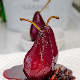 Poached pears by Yancho Zapryanov - Food & Drink Candy & Dessert ( nobody, fancy, warm, aromatic, appetizing, spice, appetizer, glaze, creme, gourmet, dessert, wine, glazed, sour, fruit, cinnamon, balm, spicy, plate, sauce, close-up, cream, product, holiday, anise, sweet, red, syrup, poached, pear )