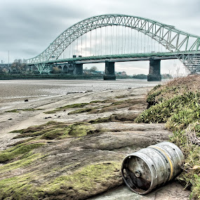 Washed Up by Jon Hunter - Buildings & Architecture Bridges & Suspended Structures ( runcorn bridge, sand, beer, hdr, runcorn, river mersey, barrel, rocks, jubilee bridge, river )