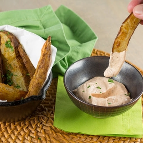 Spicy Baked Potato Wedges with Cajun-Sour Cream Sauce