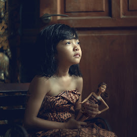 Dream a Dream by Ganjar Rahayu - Babies & Children Child Portraits ( child, potrait, wooden, sephia, girl, batik, daughter, traditional, barbie )
