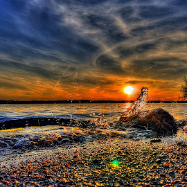Against the Rock by Derrill Grabenstein - Landscapes Sunsets & Sunrises