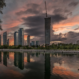 Sunset on Humber Bay by Tracy Munson - City,  Street & Park  Skylines ( clouds, skyline, reflection, park, hdr, canada, skyscrapers, toronto, great lakes, photography, humber bay, lake ontario, condos, urban, tracy munson, sky, lakeshore, sunset, east, gta )