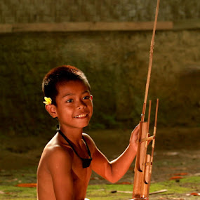 Bedu,young Angklung player. (Angklung's traditional music instrument from West Java, Indonesia) by Baron Danardono Wibowo - People Musicians & Entertainers