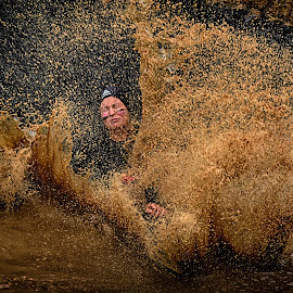 Splasher by Marco Bertamé - Sports & Fitness Other Sports ( water, differdange, splash, splatter, 2015, eyes closed, waterdrops, soup, slinding, luxembourg, muddy, strong, woman, drops, lady, brown, strongmanrun )