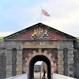Fort George Entrance by Tina Stevens - Buildings & Architecture Public & Historical ( railing, scotland, brick, 1747, architecture, entrance, army, flag of union, union jack, platform, british, fort, highlands, barbican, inverness, history, miliary, soldier, flag, entry, fortification, ardersier, 18th century, historical, crest, heraldy,  )