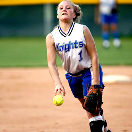The pitcher by Keith Johnston - Sports & Fitness Other Sports ( infield, ball, uniform, female, softball, game, pitch, throwing, pitching )