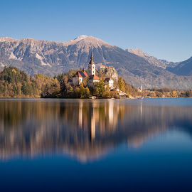 Island with a church in Bled, Slovenia by Péter Mocsonoky - Buildings & Architecture Places of Worship ( calm, famous, reflection, europe, mountain, travel, architecture, landscape, island, alpine, nature, autumn, idyllic, bled, julian, alps, water, hill, building, church, beautiful, white, romantic, forest, tourism, lake, scenic, destination, amazing, landmark, tourist, catholic, tower, european, vacation, slovenia, fall, background, outdoor, scene, view, scenery )