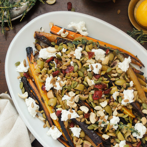 Middle Eastern roasted carrots with olives, goat cheese, salad topper and harissa-preserved lemon dressing