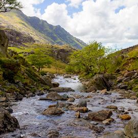 River Nant Peris by Craig Hutton - Landscapes Mountains & Hills ( clouds, mountains, llanberis pass, sky, river nant peris, wales, trees, snowdonia, landscape, rocks )