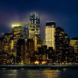 Cloudy Manhattan Night by Finley Delouche - City,  Street & Park  Skylines ( water, manhattan skyline, new york skyline, travel location, one world observatory, cloudy, manhattan, night city, night, nyc, new york city, waterfront, city skyline, river, hudson river )