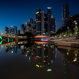 The Blue Skyline by Gordon Koh - City,  Street & Park  Skylines ( shenton way, skyline, reflection, still, cityscape, singapore, city, tranquil, skyscraper, vista, asia, night, bridge )