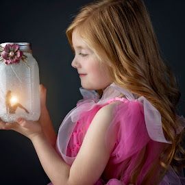 A little magic by Carole Brown - Babies & Children Child Portraits ( little girl, red hair, pink tulle dress, lit jar, tinkerbell )
