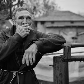 Life is by Bojan Kostadinovic - People Portraits of Men ( cigarette, old, village, black and white, old man, men )