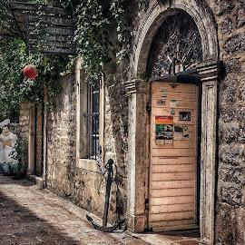 a street with the anchor by Zeljko Samardzic - City,  Street & Park  Street Scenes ( doors, montenegro, old, mediterranean, sea, stone, town, wall, anchor )