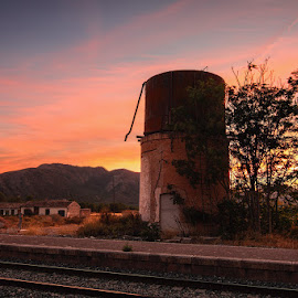 Sunset at the old Railway Station. by Francisco Garcia Rios - Buildings & Architecture Decaying & Abandoned ( españa, hellín, water tank, rails, station, colors, twilight, recesvintus, dusk, spain, sky, railway, sunset, sundown, agramón, albacete, evening )