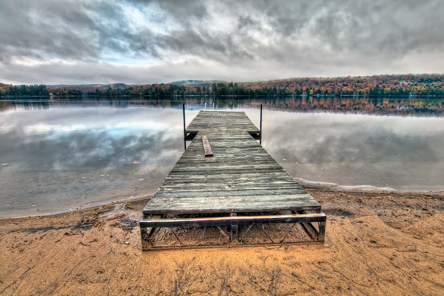 Fall Dock by James Wheeler - Landscapes Waterscapes ( calm, reflection, wood, travel, photography, dock, dramatic, 2011, algonquin park west, nikon, september, dwight, oxtongue lake, clouds, water, sand, canada, hdr, fall dock, d5000, ontario, high dynamic range, algonquin colors, photo, picture, fall, northern ontario, trees, october, landscapes, geotagged )