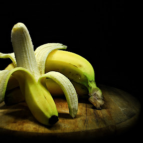 Resting Banana by Suehana SuZie - Food & Drink Fruits & Vegetables ( banana, fruit, stock, still life, wallpaper, yellow, black )