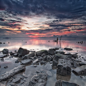 Man and Cloud by Fairuzee Ramlee - Landscapes Sunsets & Sunrises ( water, waterscape, sunset, stone, cloud )