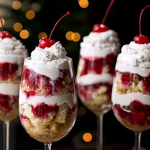 "Boozy New Year's Eve ""Party In A Glass"" Parfait with Grand Marnier-Soaked Pound Cake, Raspberries and Chambord Whipped Cream, topped with Maraschino Cherries and Edible Silver Confetti"