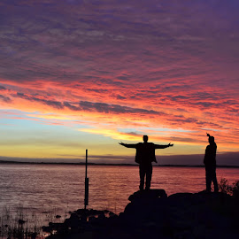 Strike a Pose by Jack Hamer - Landscapes Cloud Formations ( clouds, color, sunset, silhouettes, lake, posing )