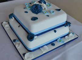 2 tiered square blue themed wedding cake