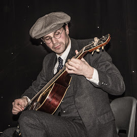 The guitarist by Janet Packham - People Musicians & Entertainers ( music, playing, model, male, guitarist, guitar, musician, instrument, entertainer, man )