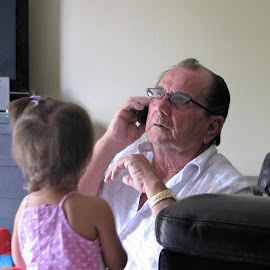 Poppa playing with granddaughter by Priscilla Renda McDaniel - People Family ( playing, grandmas glasses on, poppa, grandpa, having fun, on fake phone, family time )
