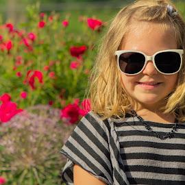 Nicole Among The Flowers by Julie Wooden - Babies & Children Children Candids ( child, girl, north dakota, nature, park, colorful, bismarck, colors, outdoors, nicole, summer, summer fun, flowers, kid )