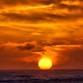 Sun setting by Gaylord Mink - Landscapes Sunsets & Sunrises ( water, setting, ocean, sun )