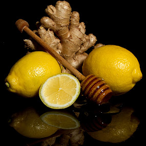 Cold Remedy by SumPics Photography - Food & Drink Ingredients ( homeopathic, symptom relief, ginger, honey dipper, flu, tea, cold cure, common cold, honey, cold, remedy, fresh, lemon )