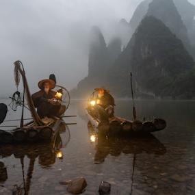 Still Fishing by Andy Chow - People Professional People ( guilin, china, dusk, fishermen, li river, cormorant, lantern )