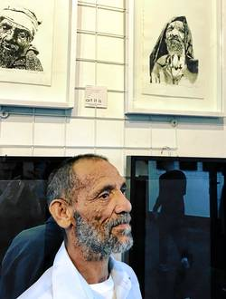 Joseph Buys, an inmate at Drakenstein Correctional Services in Paarl (formerly Victor Verster Prison) with two of his etchings that can be seen at the 'Identity' exhibition in Cape Town