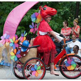 Parade the Circle by Ginny Anderson - People Musicians & Entertainers ( red horse, parade, lady, bicycle )