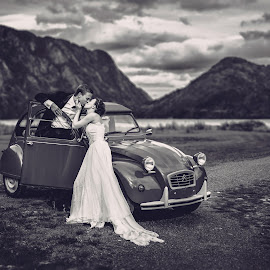 the Kiss by Bendik Møller - Wedding Bride & Groom ( car, clouds, monochrome, sky, mountain, black and white, wedding, bride and groom, landscape, bride, mono )